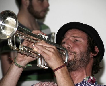 chris playing the trumpet